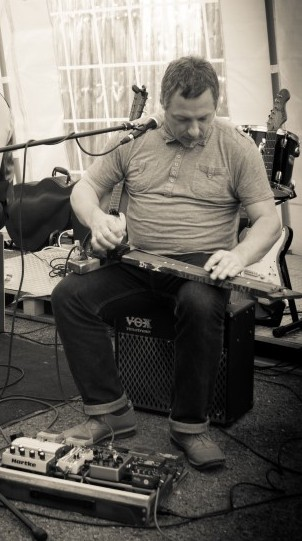 Dr X playing a diddley bow