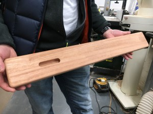 Martin holding the body of the Diddley Bow before paint